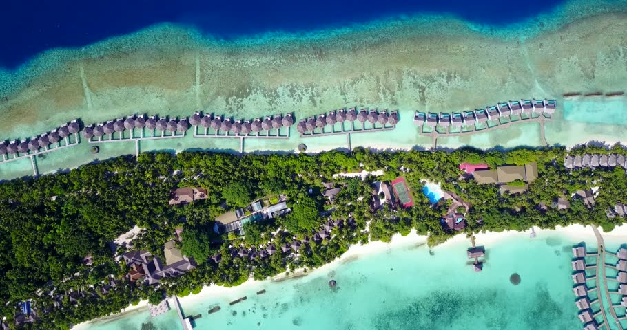v09492 five 5 star resort water bungalows in Maldives with drone aerial flying view on white sand beach on tropical island