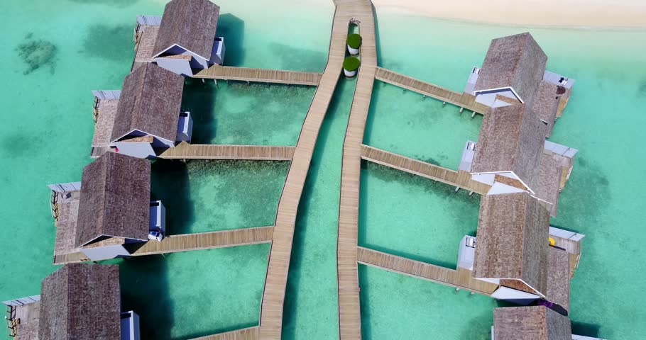 v09427 five 5 star resort water bungalows in Maldives with drone aerial flying view on white sand beach on tropical island