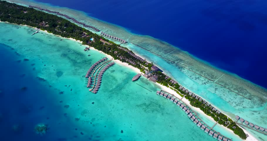 v09479 five 5 star resort water bungalows in Maldives with drone aerial flying view on white sand beach on tropical island
