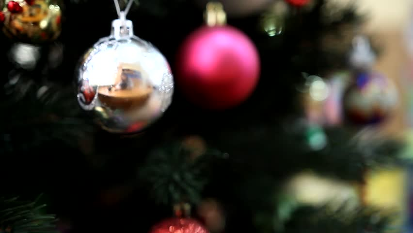 A Multi Colored Christmas Garland Lies On The Christmas Tree  - Multi Color Christmas Tree Decorations