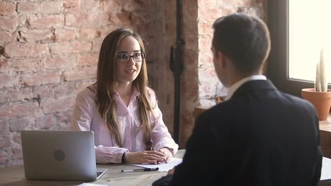 Young female hr manager handshaking welcoming hired employee got new job, employer shaking hands congratulating employed candidate after successful interview, make deal with client, conclude contract