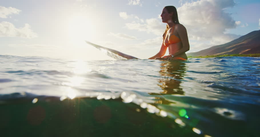 Beautiful young woman surfing at sunset | Shutterstock HD Video #32245447