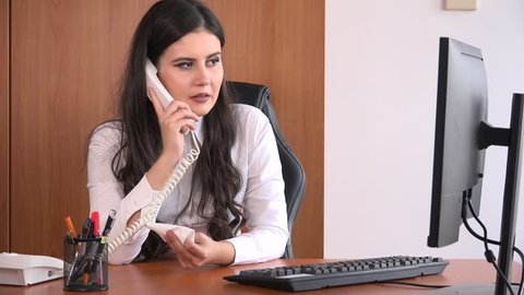 Young relaxed office worker person on landline phone call blowing nose cold flu