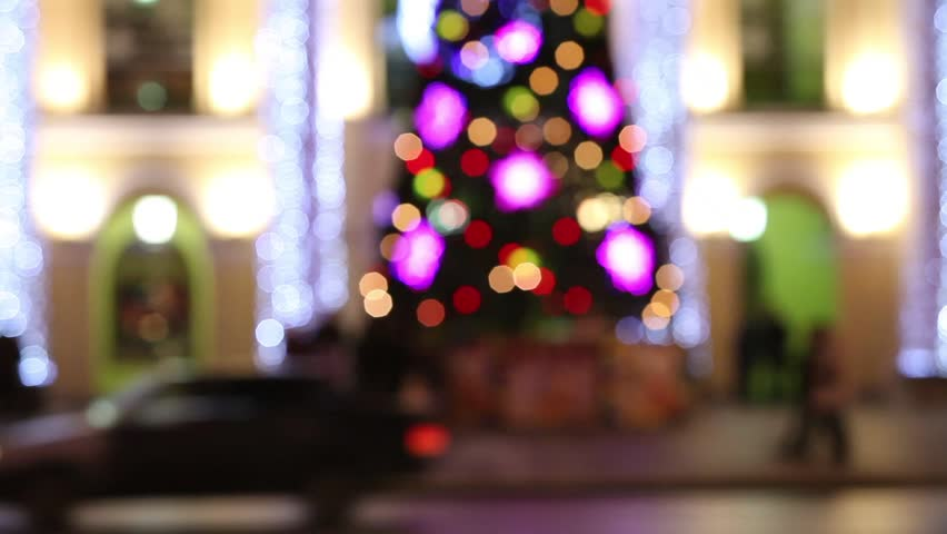 Christmas tree in the night city defocused