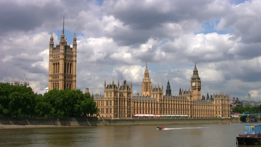 Dark clouds gathering over the Houses of Parliament and the river Thames in London | Shutterstock HD Video #32335822