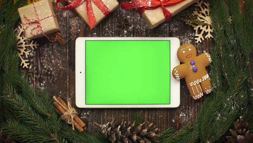 Look from above at tablet with green screen lying among Christma | Shutterstock HD Video #32347612
