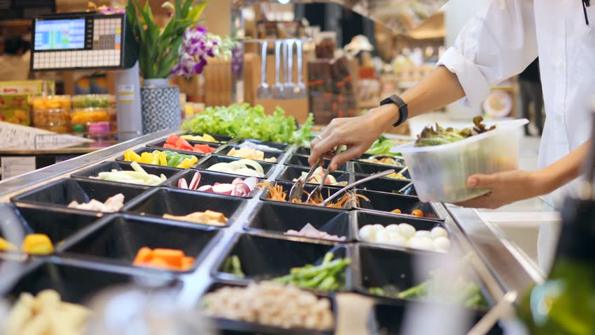 Salad Bar in Shopping Mall. Young Woman Buying Organic Vegetables for Salad. Vegetarian Take Away Food Fitness Diet Healthy Lifestyle Concept. 4K. #32375392
