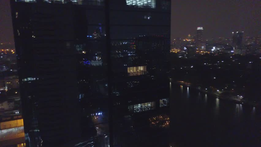 Bangkok city office building downtown night view. Blurred city lights night view abstract background