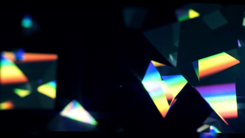 Rainbow triangle prisms float close up on black background   Shutterstock HD Video #3245773