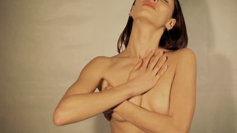 people, dehydration, skincare, 4k, movie, beauty and Slow motion concept - Woman applying cream her body. Sensual woman moisturization skin. Young woman cares face skin relaxation, neck, cleanliness