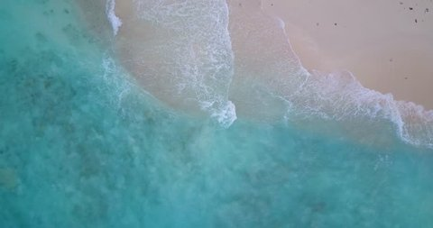 v14322 waves water texture breaking and crashing with drone aerial flying view of aqua blue and green clear sea ocean