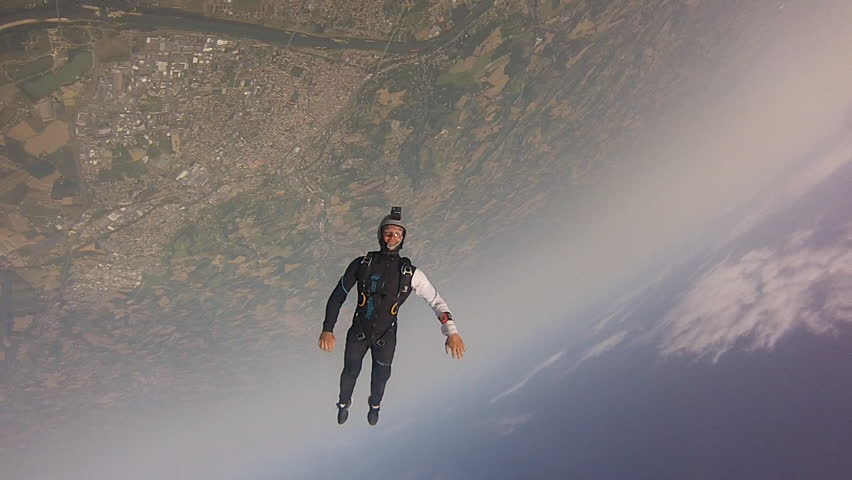 WS POV Skydiver falling against blue sky / Agen, France #32486572