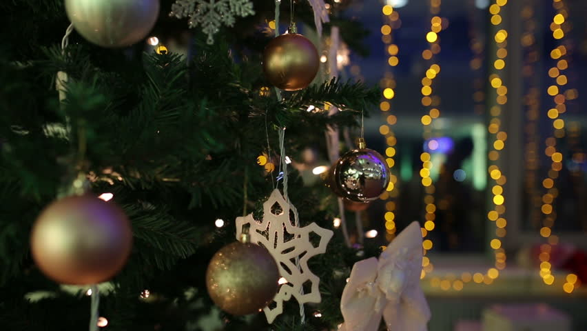 the close up view of the christmas tree decorated with christmas balls and snowflakes - Christmas Tree Bubble Lights