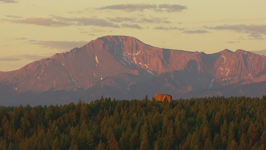 WS AERIAL Forested hills at sunset, Pikes Peak / Colorado, USA