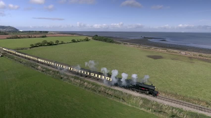 Gorgeous aerial shot of a coastal steam train on the West Somerset steam railway in Blue Anchor, UK.