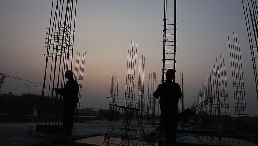 Worker working with concrete reinforce iron near sunset | Shutterstock HD Video #3259372