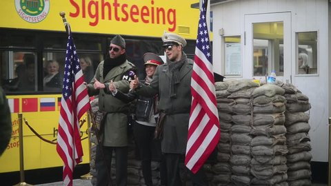 BERLIN, GERMANY - OCTOBER 14, 2017: Checkpoint Charlie, Berlin, Tourists make Photo with actors as American Soldiers