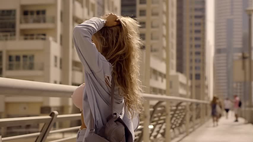 Happy woman tourist in Dubai, Marina district. Girl traveler with backpack on the bridge to get out of the bag | Shutterstock HD Video #32603392