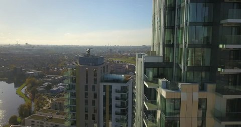 Aerial drone footage of apartment buildings in Woodberry Down, London, England on a bright sunny day.