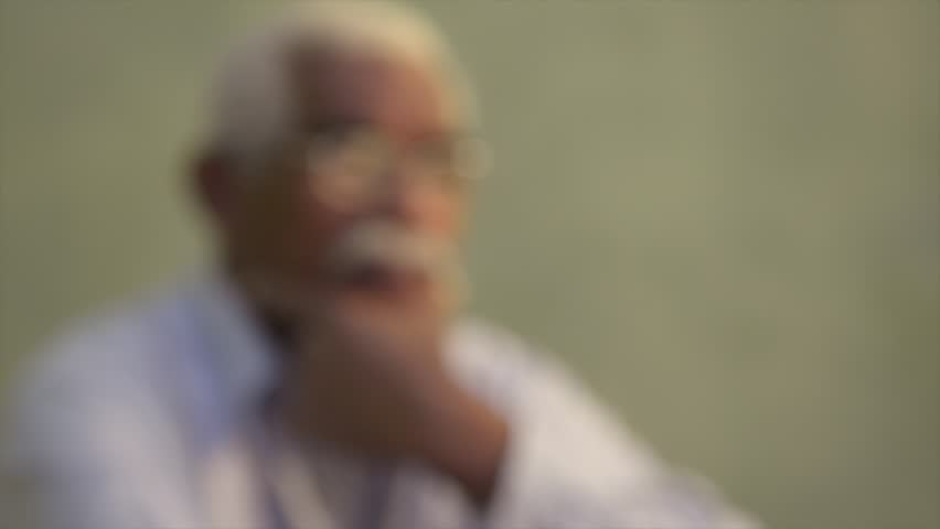 Black people and emotions, portrait of depressed senior man with glasses looking away. Sequence