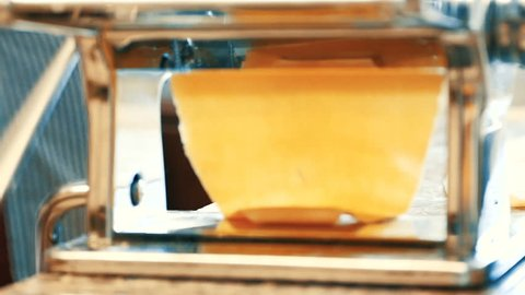 chef made pasta from hand pasta machine, home cooking style, warm and cozy kitchen