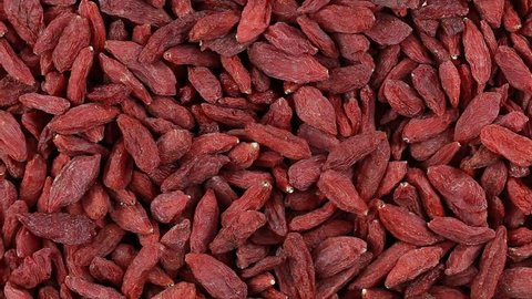 Dried Goji Berries. Loop rotation. Front of the camera rotates plate with bright berries. Close up