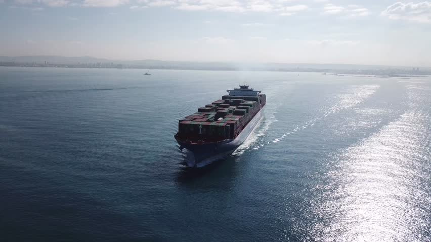 Huge large mega ULCV container ship sails on open water fully loaded with containers and cargo - aerial 4k view | Shutterstock HD Video #32664892