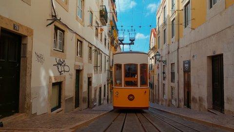 LISBON, circa 2017 - Wide angle view of the quaint Elevador da Bica funicular tram elevator, aka Ascensor da Bica, travelling downhill from the Largo do Calhariz square in Lisbon, Portugal.