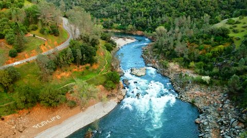 Aerial of American river near Foresthill, Auburn-Foresthill or Auburn road bridge crossing over the North Fork American River in Placer County and the Sierra Nevada foothills, in eastern California.