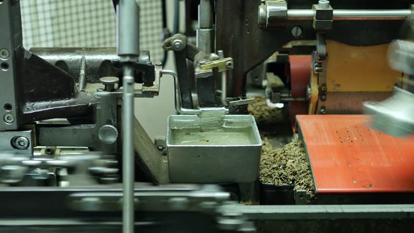 Cigar rolling machine inside a cigar factory producing homemade cigars – 4K   Shutterstock HD Video #32712262