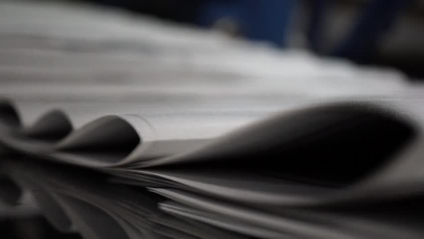 Print the newspaper from a short distance. The process of offset and roll printing. Production of the newspaper. Paper passing from the press.