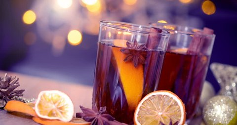 Mulled wine in night celebration of  New Year party and delicious Christmas drink for autumn and winter season , vintage color tone , 4K Dci resolution