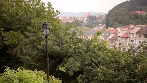 Top view of Sighisoara houses rooftops with lamp post in foreground.