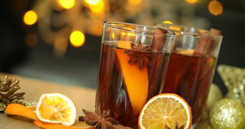 Mulled wine  in night celebration of  New Year party and delicious Christmas drink for autumn and winter season , 4k Dci resolution
