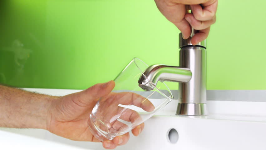 Filling glass of mains water, drinking water