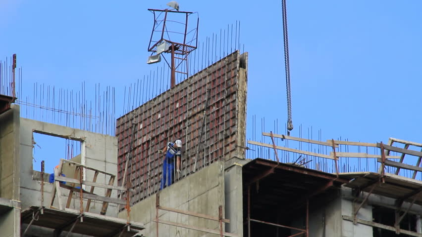 Workers on monolith construction worked on high altitude of building