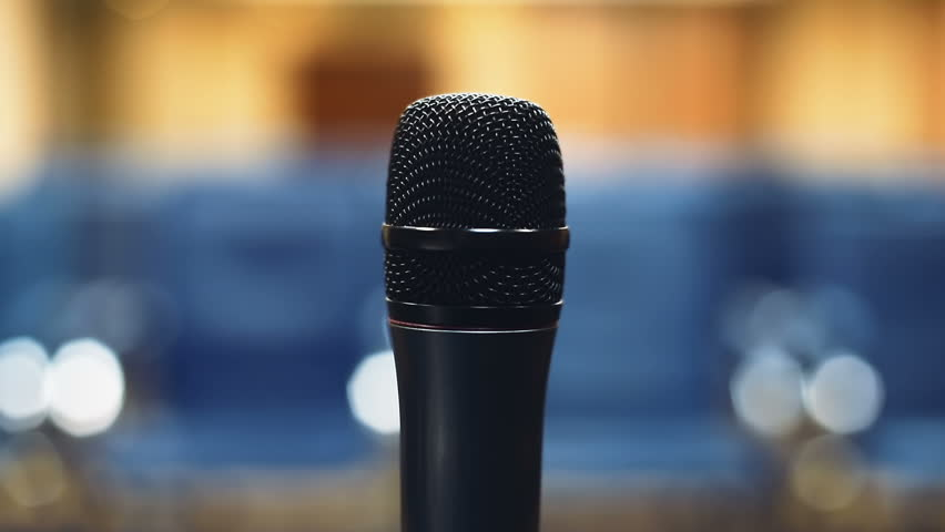 Close-up microphone mic mike speaker place empty conference hall public meeting room business training blue seats background nobody social presentation political speech seminar lecture presentation | Shutterstock HD Video #32812552