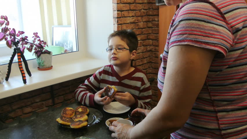 Grandson Eats At Grandma S Cote Cheese Pancakes With Honey Boy Cooking Visiting