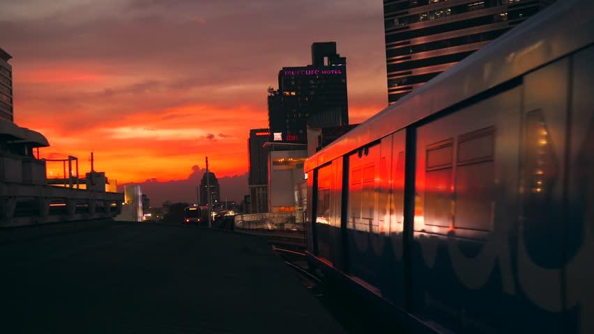 Beautiful Golden Sunset in Bangkok City with BTS Metro Subway Train Leaving from the Station Siam. 4K. Bangkok, Thailand - 12 NOV 2017.
