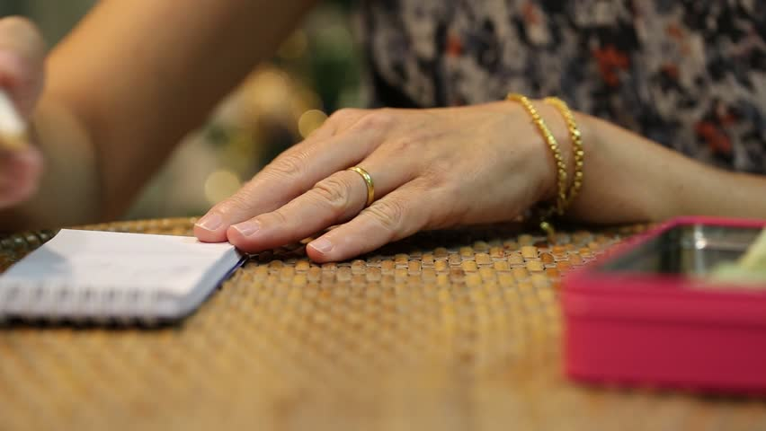 Woman hand counting money closeup on table blur background | Shutterstock HD Video #32831725