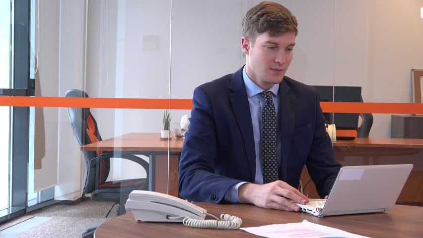 Online video call conference meeting inside office young business man use laptop | Shutterstock HD Video #32836147