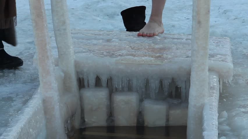 Stock video of closeup of the legs of a 7169017 shutterstock hd0012st petersburg jan 19 the woman bathing in an ice hole on january 19 2013 temperature of 14 degrees the river neva st petersburg russia publicscrutiny Gallery