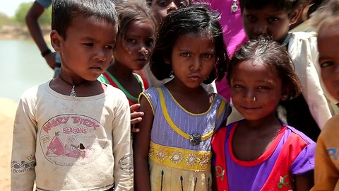 April 2016. India. Bihar. Scared poor indian village children. Children of Third World Countries. Portraits of beggars dirty child.