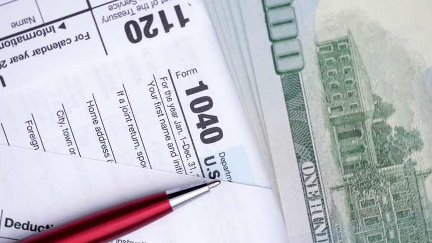 Tax forms 1120, 1040, pen, dollar bills, and calculator. High angle view.  | Shutterstock HD Video #32924653