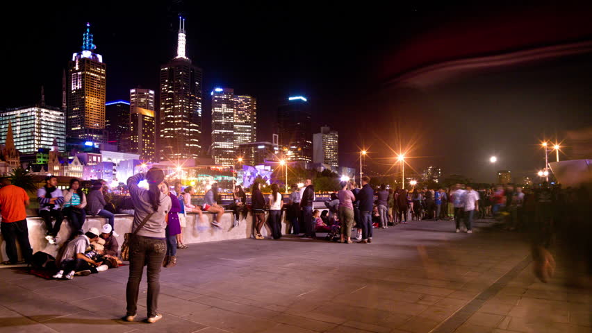 MELBOURNE- DECEMBER 31: crowds of people rushing around in south bank Melbourne, AUSTRALIA DECEMBER 31, 2012 (Time Lapse)