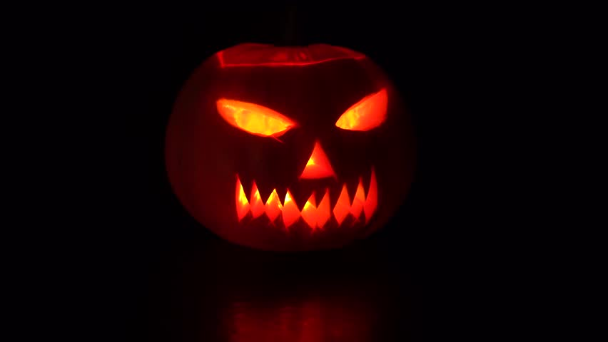 Halloween celebration glowing pumpkin in the dark | Shutterstock HD Video #32953282