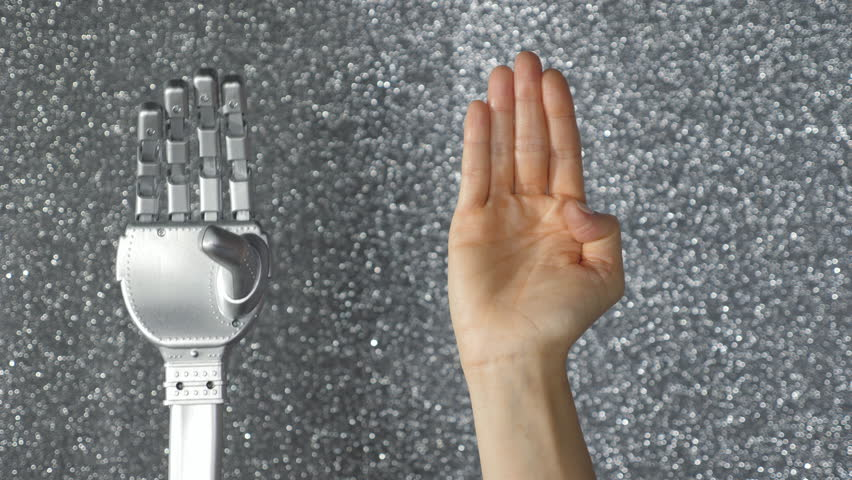 Silver robotic toy hand mimics clenching gesture of human female hand. Artificial intelligence.  | Shutterstock HD Video #32958082