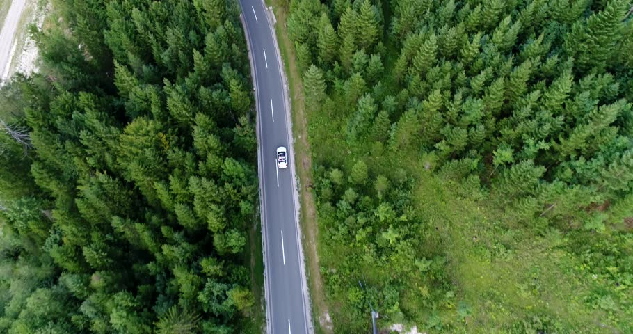 Above view from copter at the car driving along the road in Austria. | Shutterstock HD Video #32983642