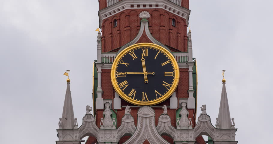 Moscow Kremlin Main Clock named Kuranti on Spasskaya Tower 12 hours . Red Square. Timelapse