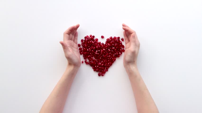 Pomegranate heart on a white background